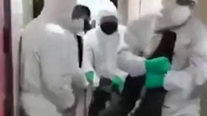 Footage Shows Suspected Coronavirus Patients Being Dragged From Their Homes