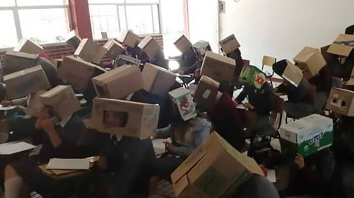 Teacher Stops Kids Cheating In Exam By Putting Cardboard Boxes On Their Heads