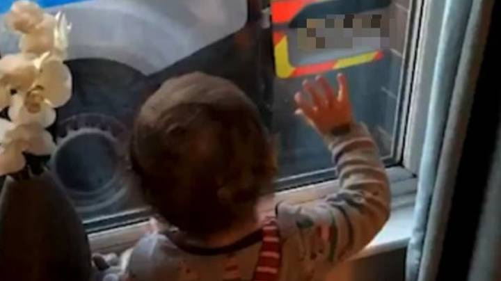 Toddler Innocently Waves As Man In Handcuffs Is Put Into Back Of Police Van