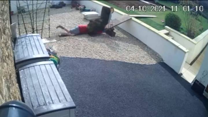 Man Drops Entire Wheelbarrow Of Soil Over Himself After Falling Off Ramp