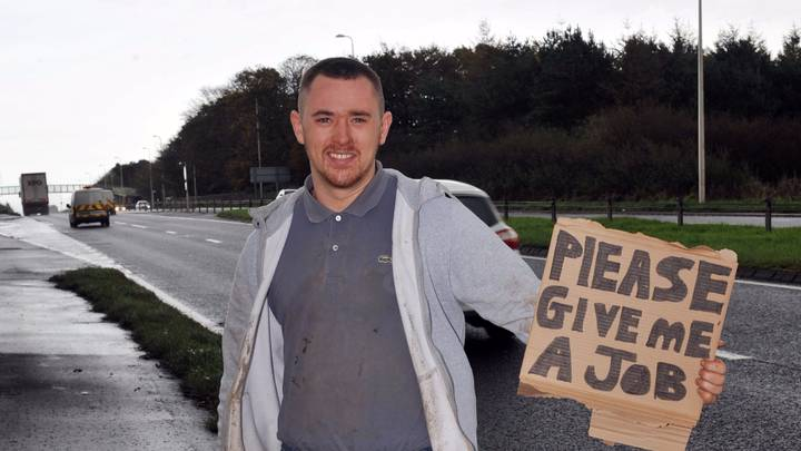 Inventive Unemployed Labourer Finds Work Standing By Motorway With Sign