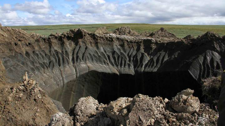 Gigantic 165ft Deep Crater Forms In Russia's Arctic Tundra After Explosion