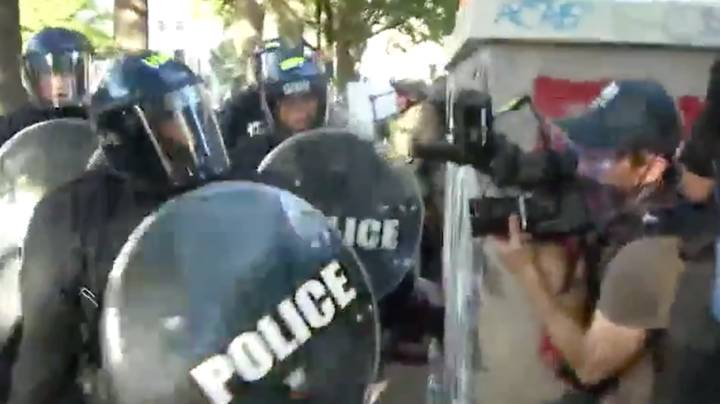 Two American Cops Have Been Reprimanded For Assaulting Australian News Crew