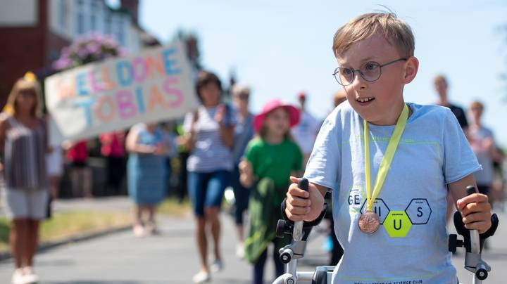 Boy With Cerebral Palsy Raises £80,000 For Charity With 'Captain Tom' Marathon