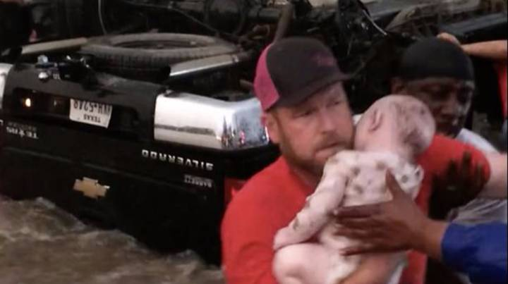 Heroes Rescue Two Toddlers From Car Overturned By Floodwater