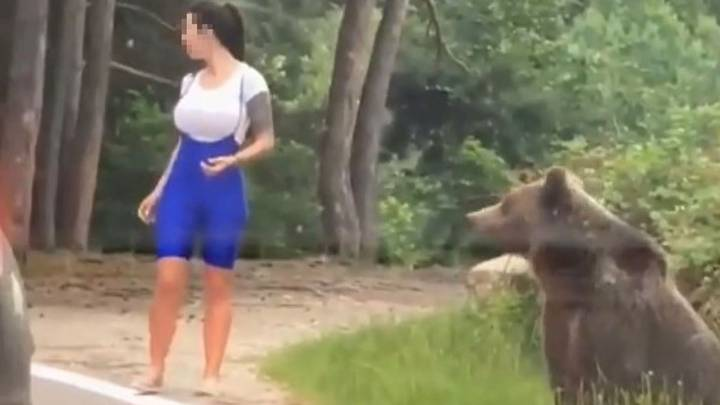 Bear Lunges At Woman Trying To Take Photograph Next To It