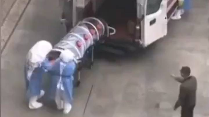 Coronavirus Patient Transported In Plastic Tube To Stop Disease Spreading