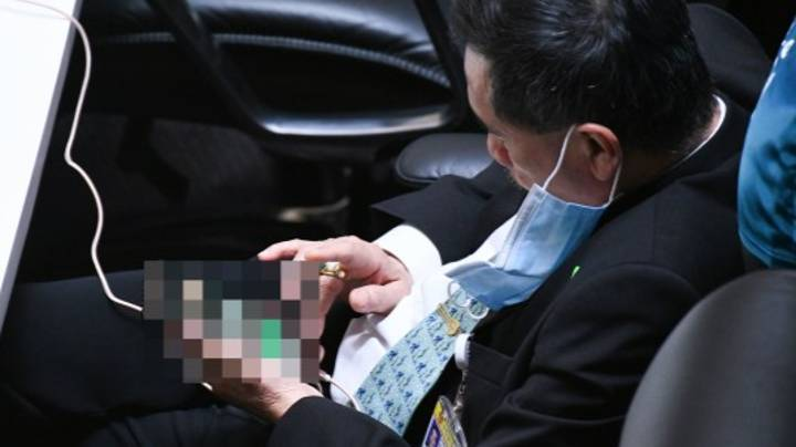 Thai MP Caught Looking At Porn On His Phone In Parliament