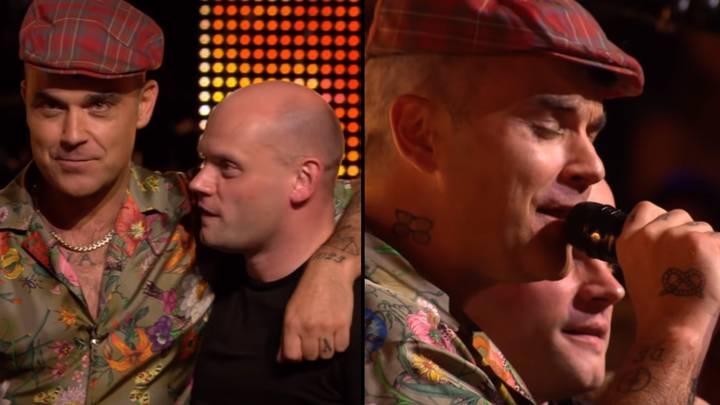 Robbie Williams Makes Fan's Dream Come True And Joins Him On Stage To Sing 'Angels'