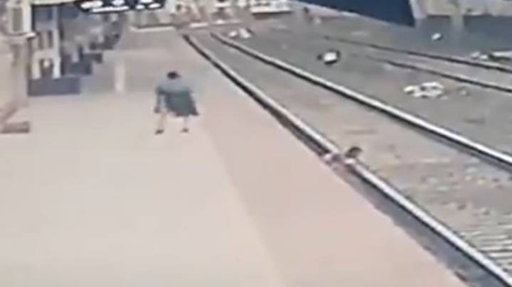 Man Saves Child's Life From Oncoming Train In Heart-Stopping Video