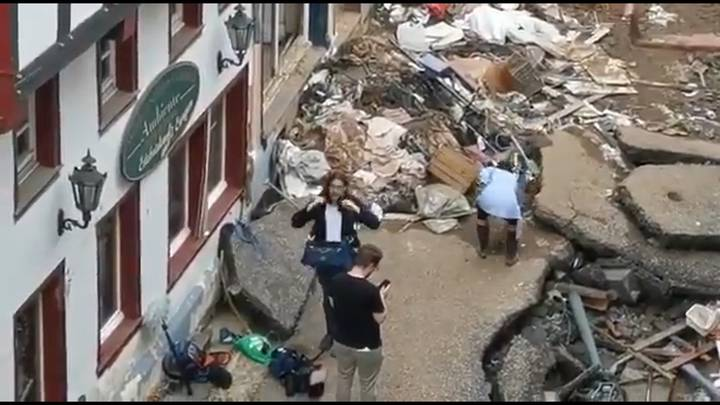 Reporter Apologises After Being Caught Muddying Herself During Flood Clean Up
