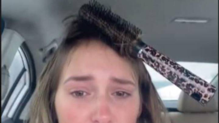 Woman's Attempt At Hair Styling Leaves Her With Hairbrush Stuck To Head