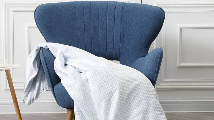 A Cooling Blanket Is Here For The Hot Sleepers Among Us