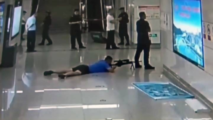 Police Sniper Shoots Hostage Taker From Between Colleague's Legs