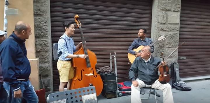 Tourist Joins In With Street Musicians