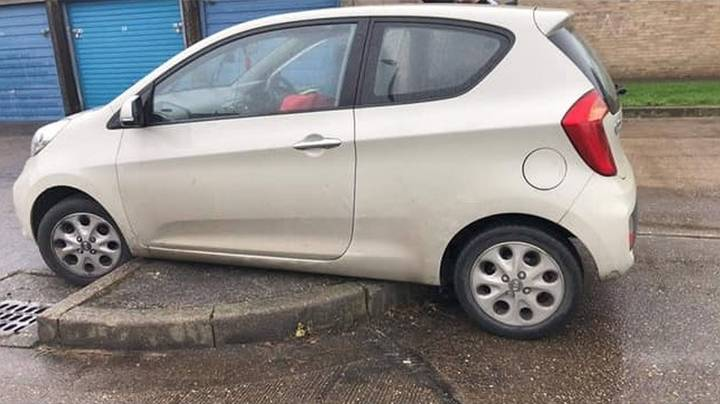 Man Gets His Car Wedged Onto Kerb For An Hour While Delivering Food