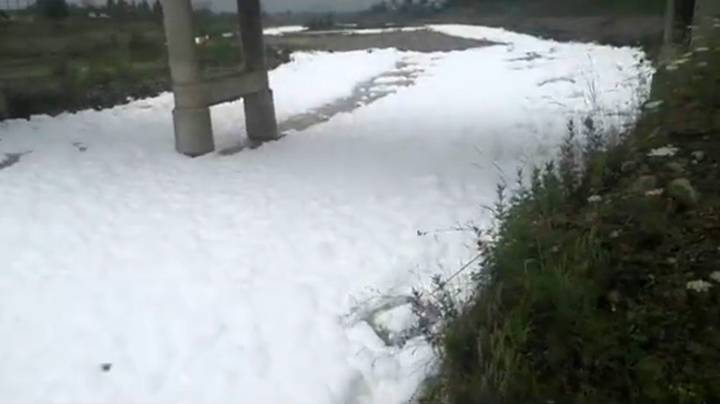 River In China Left Covered In Foam After Detergent Spill