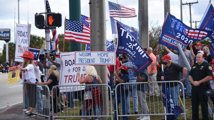 Supporters Line The Streets Welcome Trump Home As He Returns To Florida