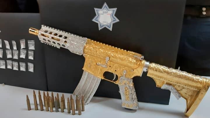 Cops Seize Golden Gun From 'Women With Moustaches' Gang