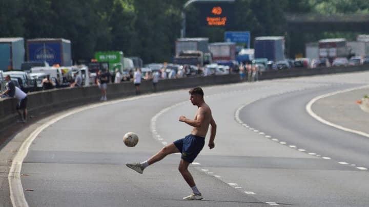 Man Plays Football On Motorway During M4 Traffic Jam