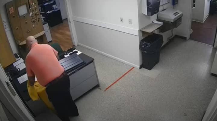 Police Chief Resigns After CCTV Footage Captures Him Putting KKK Note on Black Officer's Desk