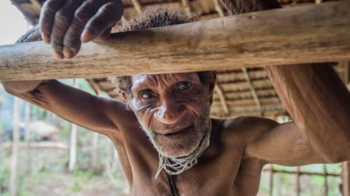 Photographer Captures Daily Life Of Elusive West Papua Korowai Tribe