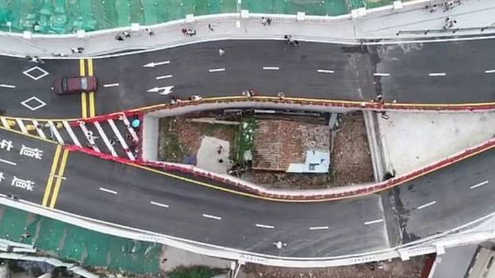 Chinese City Built Motorway Bridge Around Tiny House After Owner Refused To Move