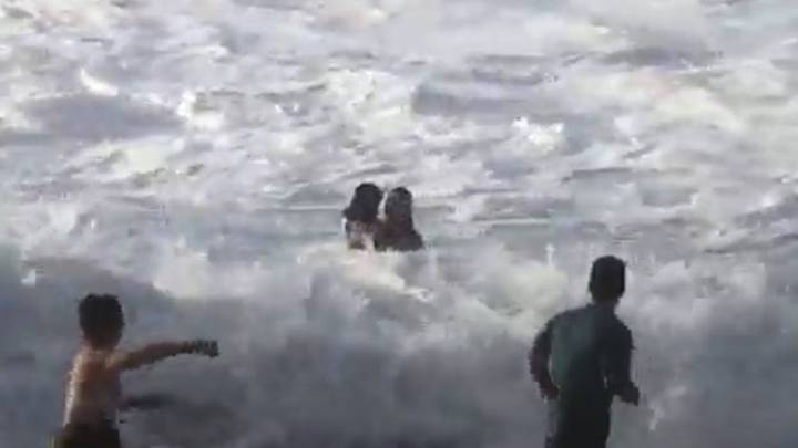 Surfer Saves Drowning Beachgoer Pulled Out To Sea In Hawaii