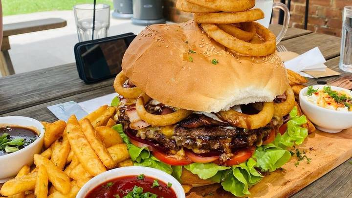 Man Becomes First To Ever Complete Australian Pub's 5kg Burger Challenge