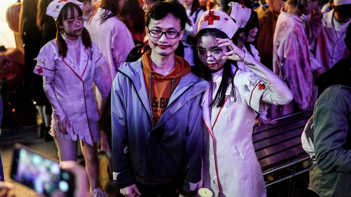 Huge Crowds Gather For Halloween Event At Amusement Park In Wuhan