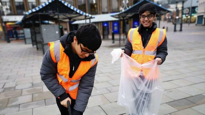 Young People Across UK Get Up Early To Clean Streets Following New Year's Eve