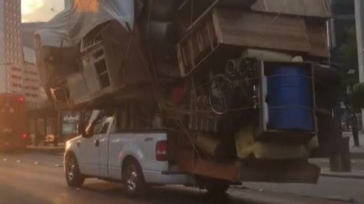 Driver Packs All Belongings Onto Slowly Moving Pickup Truck