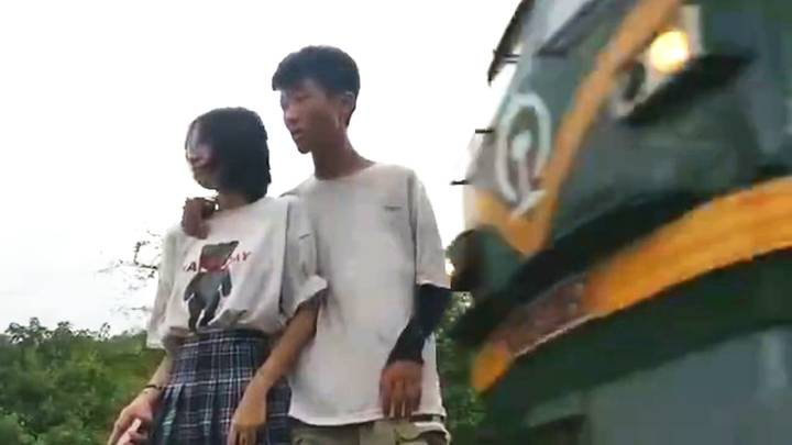 Chinese Couple Narrowly Avoid Freight Train While Filming For Social Media