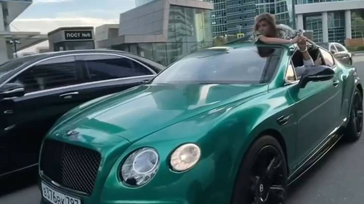 Influencer Drives With Girlfriend On Roof Handcuffed To Him In 'Trust Test' Stunt