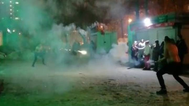 Two Men Stage 'Duel' With Fireworks In Middle Of Street In Russia