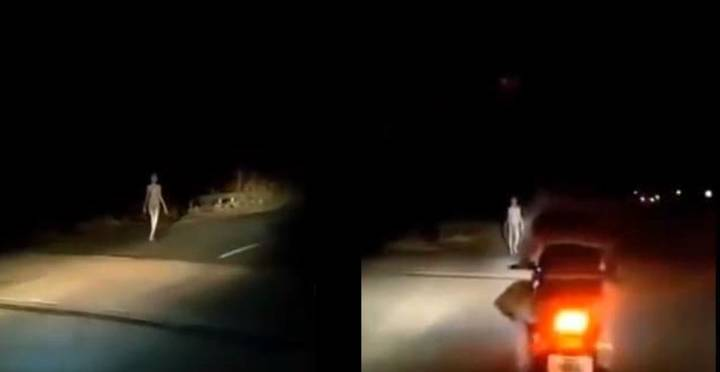 Strange 'Humanoid Alien Creature' With Long Limbs Spotted Walking Beside Road At Night
