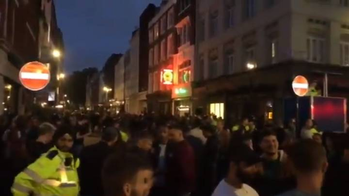 Video Shows Revellers Flooding Streets Of Soho To Celebrate Pubs Reopening