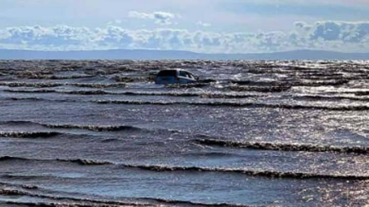 Couple's Car Sinks In Sea After Driver Wanted To 'Get Closer' To Water