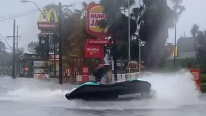 Man Jet Skis Past McDonald's Following Flash Floods In Australia