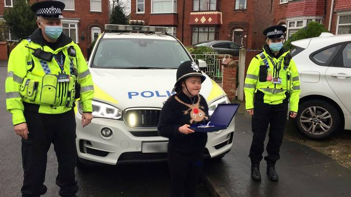 Police Swoop To 'Arrest' Girl With Down's Syndrome And Grant Christmas Wish