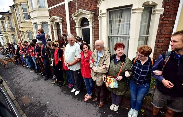 Heroic Community Forms Human Chain To Save Their Neighbour