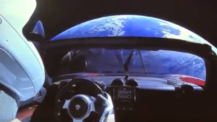 Elon Musk's Tesla Roadster Says 'Don't Panic' - And It's Quite Apt Now
