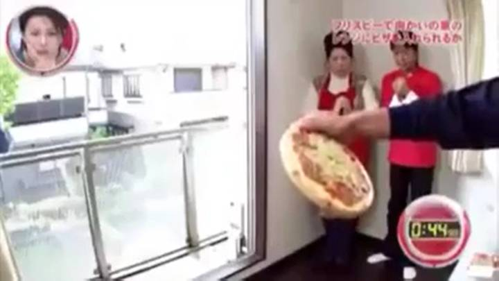 Video Shows Man Throwing Pizza Into Another Apartment's Microwave