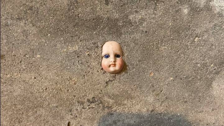 Woman Told To Move House After Finding Doll's Face In Cellar Wall