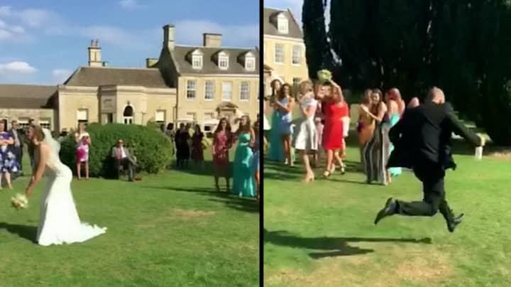 Boyfriend Runs Away After His Girlfriend Catches A Bride's Bouquet