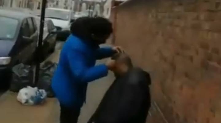 Barber Filmed Cutting Hair Outdoors In Lockdown