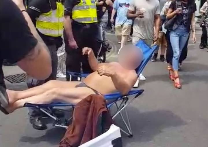 Man Wearing Speedos Is Arrested While Sitting On A Deckchair