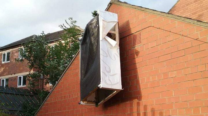 Woman Shocked To Find Bed Impaled To The Side Of Her House