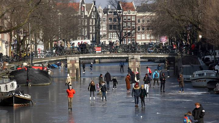Families Take To Amsterdam's Frozen Canals For Ice Skating