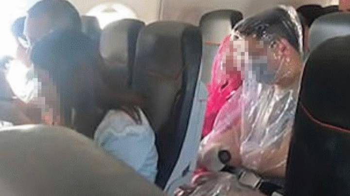 Plane Passengers Spotted Wearing Makeshift Plastic Full-Body Suits